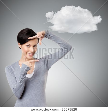 Framing hands gesture, isolated on grey background with cloud