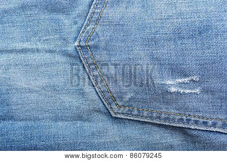 Fragment of material jeans denim texture background. Pocket.