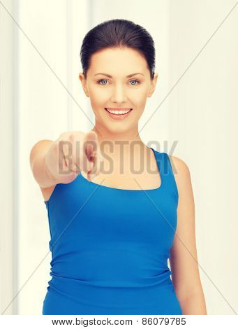 bright picture of beautiful woman pointing her finger