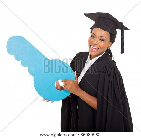 cheerful young african graduate holding blue paper key symbol