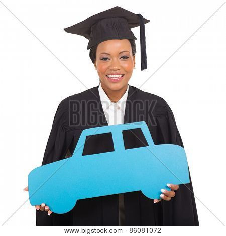 pretty young african american graduate holding a car symbol isolated on white
