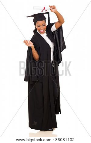 joyful female african american graduate celebrating on white background