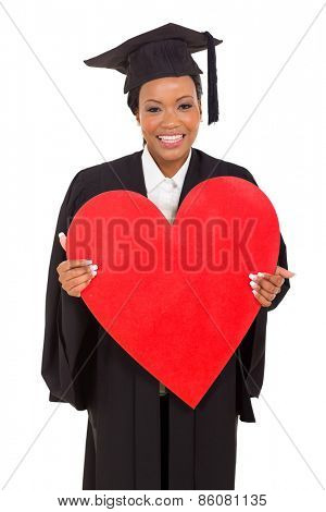 happy young african American college graduate holding heart shape over white background