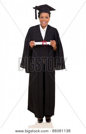 pretty female college graduate in gown and cap on white background