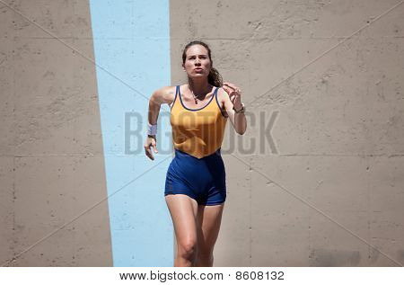 Pretty, Focused Woman Runs To Keep In Shape.