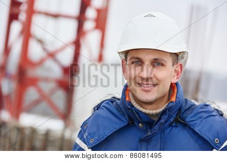 happy construction manager or building site foreman worker