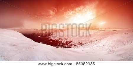 Fantastic evening winter landscape. Colorful overcast sky. Carpathian, Ukraine, Europe. Beauty world.