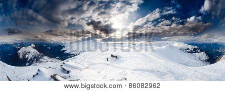 Panorama of Snow Mountain Range Landscape with Blue Sky at Carpathian mountain region. Ukrainend