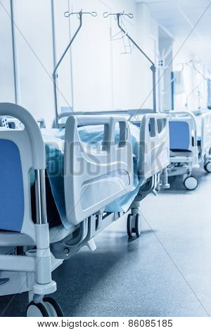 Long corridor in hospital with surgical beds. Tinted picture