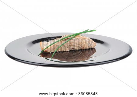 sea food : roasted pink salmon fillet with chinese onion, on black dish isolated over white background