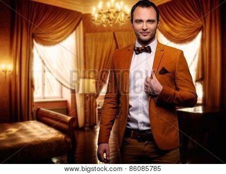 Sharp dressed dandy fashionist in luxury apartment interior