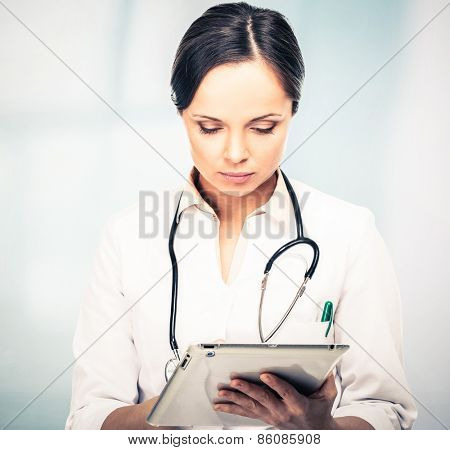 Doctor woman taking notes on tablet pc