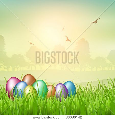 Colourful Easter eggs nestled in grass