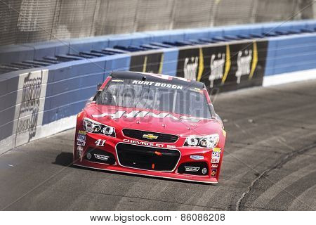 Fontana, CA - Mar 22, 2015:  Kurt Busch (41) brings his race car through the turns during the  race at the Auto Club Speedway in Fontana, CA.