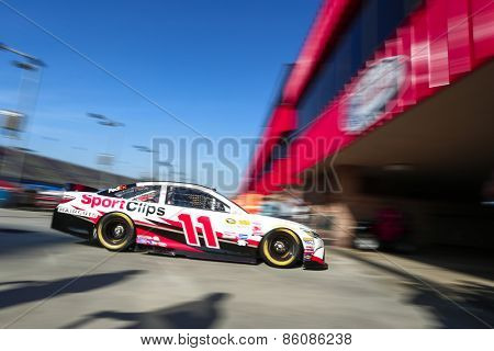 Fontana, CA - Mar 21, 2015:  Denny Hamlin (11) takes to the track to practice for the Auto Club 400 at Auto Club Speedway in Fontana, CA.