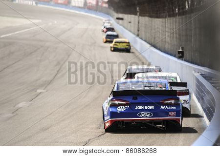 Fontana, CA - Mar 22, 2015:  Joey Logano (22) brings his race car through the turns during the  race at the Auto Club Speedway in Fontana, CA.