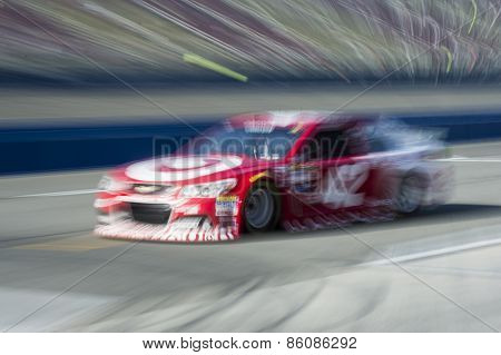 Fontana, CA - Mar 21, 2015:  Kyle Larson (42) takes to the track to practice for the Auto Club 400 at Auto Club Speedway in Fontana, CA.