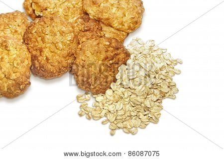 Oatmeal cookies and oat-flakes isolated on white background