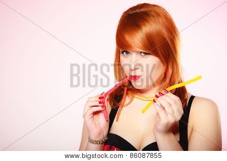 Redhair Girl Holding Sweet Food Jelly Candy On Pink.