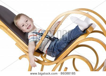 Child on a rocking chair