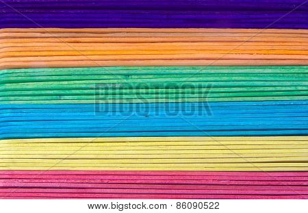Set of holiday craft sticks on a white background. Colourful depressors