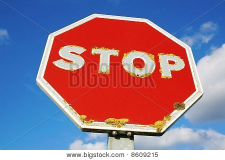 Old Stop sign over blue sky