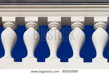 White Baluster Against A Blue Sky