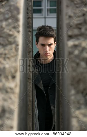 Handsome Young Man Outdoor Seen Between Two Walls Or Stones