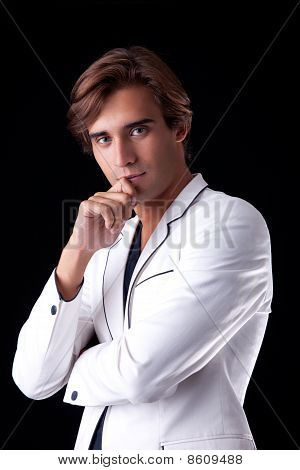 Portrait Of A Handsome Man With His White  Coat, Isolated On Black. Studio Shot