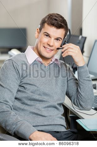 Portrait of smiling male customer service representative working in office