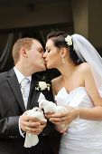 picture of hand kiss  - newlyweds holding white doves in their hands - JPG