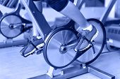 foto of exercise bike  - Exercise bike with spinning wheels - JPG