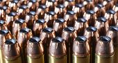 stock photo of hollow point  - Hollow point bullets on cartridges for a forty four magnum - JPG