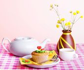 pic of kettles  - White kettle cup of tes cake and yellow flowers on a checkered tablecloth - JPG