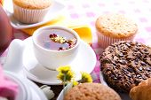 image of continental food  - continental breakfast with croissants cake chocolate cookies and tea - JPG