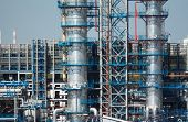 stock photo of fraction  - Close up of the fractionating columns of the Moscow oil refinery in Kapotnya district with heat haze optical effect - JPG