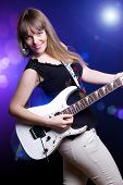 Постер, плакат: Fashion Girl With Guitar Playing Hard Rock