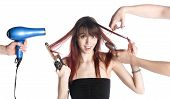Постер, плакат: Hairstylists Styling the Hair of a Young Woman