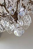 image of chandelier  - Pendants of a glass chandelier in a room - JPG