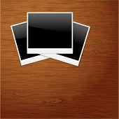 pic of polaroid  - Polaroid Photo Frames on Wooden background  - JPG