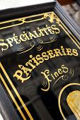 stock photo of french pastry  - Sign on the panel of an old French pastry shop - JPG