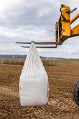 stock photo of fertilizer  - The bags with fertilizers inside used in fertilizing action in spring time - JPG