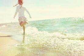 image of children beach  - Soft image of a child running on the beach - JPG