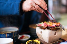 image of japanese magnolia  - Traditional Japanese lunch with hida beef prepared on grill - JPG