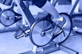 stock photo of cardio exercise  - Exercise bike with spinning wheels - JPG