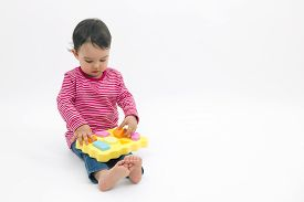 picture of daycare  - little girl learning shapes early education and daycare concept - JPG
