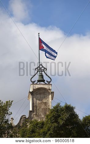 Cuba. Havana. A flag over the city museum of colonial history of Havana.