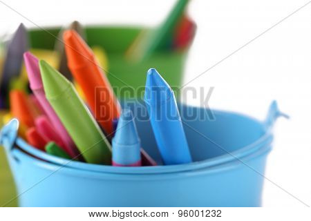 Colorful pastel crayons in holders, closeup