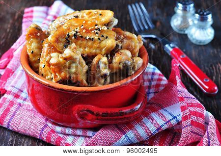 baked chicken wings in soy sauce with sesame seeds