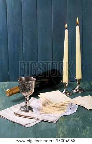 Matzo for Passover with metal tray and wine on wooden background